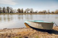 Boat at the riverside - stock photo