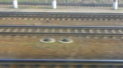 Traveling by train, track quickly rush past Stock Footage