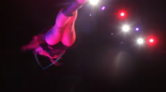 The girl performs a trick in circus Stock Footage