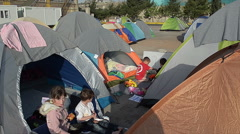 EDITORIAL: Children of Syrian refugees in the tent camp are playing games Stock Footage