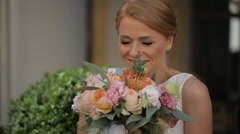 Smiling bride holding big wedding bouquet - stock footage