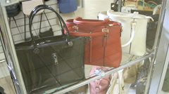 Black, Red and White Handbags in the Shop Window Stock Footage