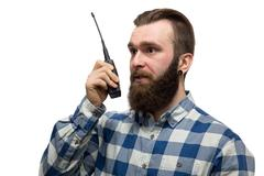 Man with a walkie-talkie on a white background Kuvituskuvat