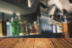 Composite image of bottles arranged on a shelf - stock illustration