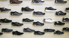 Men's Sports Shoes in the Shop Window Stock Footage