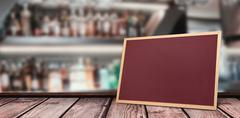 Composite image of wine glasses suspended on a rack against bottle shelf Stock Illustration