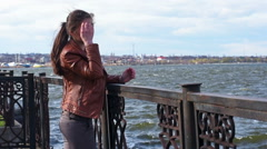 Mysteriously lonely girl touches her hair in the wind - stock footage