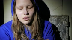 Sad teen girl near thinking about something and crying. Close up. 4K UHD - stock footage