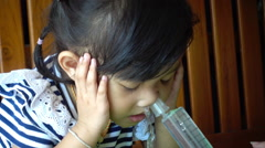 Closeup on a  little asian girl nasal irrigation, HD - stock footage