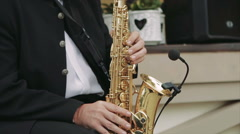 Musician Playing the Saxophone in the Street - stock footage
