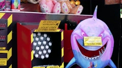 Plush toys and target in stand with souvenir and attraction Stock Footage