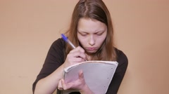Close-up of an exhausted young woman working or preparing for her exam Stock Footage