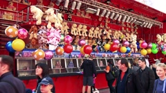 Stand with plush toys and other souvenir in funfair Stock Footage