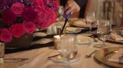 Lighting Candle Reception Table - stock footage