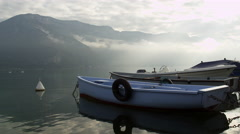 Boat Floats Placid Beautiful Lake with Mountains 5K HD Stock Video Footage - stock footage