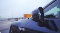 View of left side blue new car stand on street. Presentation. Front mirror - stock footage