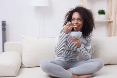 Beautiful african woman is enjoying healthy food - stock photo