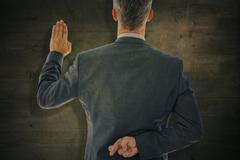 Composite image of rear view of businessman taking oath with fingers crossed Stock Photos