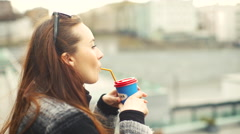 Woman Drinking Coffee From a Straw Stock Footage