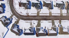Moving aerial view looking straight down on suburban homes, neighborhoods Stock Footage