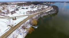 Aerial view of wealthy riverfront homes covered in fresh snow Stock Footage