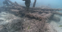 Sunken wrecked jetty covered in fishing line, underwater, discarded fishing Stock Footage