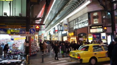 Pedestrians walking around the Dotonbori Nanba shopping district in Osaka, Japan - stock footage