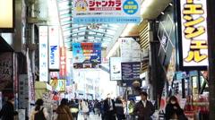 Pedestrians walking around the Dotonbori Nanba shopping district in Osaka, Japan Stock Footage