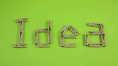 Clothespins showing the word of Idea Stock Footage