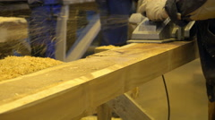 Electric planer cuts off the top layer of the large bar and the pressure throws Stock Footage