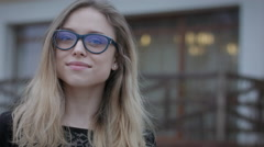 Portrait Of Beautiful Teen Girl With Glasses Posing And Smiling Outdoors - stock footage