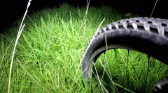 Bicycle POV night, grass Stock Footage