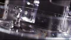 Drop of water in a glass slow motion 3 Stock Footage