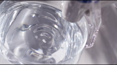 Drop of water in a glass slow motion 7 Stock Footage