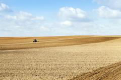 Tractor plowing the fields Stock Photos