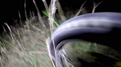 Bicycle POV night, long grass, crash Stock Footage