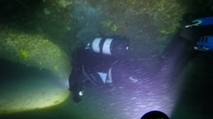 Scuba Diver Exploring an Underwater Cave Stock Footage