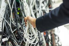 Lan cable in network room - stock photo