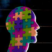 Head made of jigsaw pieces - stock illustration