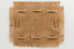 Frame made of burlap with a fringe and rope Stock Photos