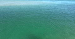 Ocean scenery calm green bay, shallow channel between sand bars, in estuary, 4K Stock Footage