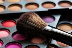 Eyeshadow Palette and brush - stock photo