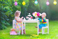 Children at doll tea party - stock photo