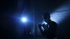 Mans is practicing kick in a boxing gym. Slow motion - stock footage