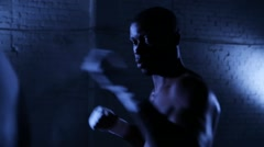 Afro-american boxer athlete shadow boxing in gym Stock Footage
