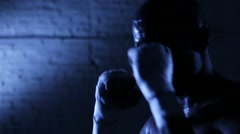 Afro-american boxer athlete shadow boxing in gym. Closeup Stock Footage