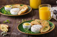 Grilled camembert with toast and juice - stock photo