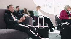 Adult business male sleeping in airport waiting lounge Stock Footage