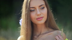 Young girl close-up with flower in her hair Stock Footage