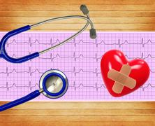 Heart analysis, electrocardiogram graph (ECG), heart and stethoscope on woode - stock photo